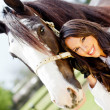 Woman with a horse — Stock Photo #9557714