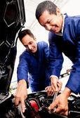 Mechanics fixing a car — Stock Photo