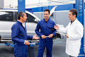 Group of mechanics talking — Stock Photo