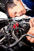 Mechanic fixing car engine — Stock Photo