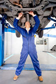 Mechanic working on a car — Stock Photo