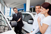 Couple at the dealership — Stock Photo