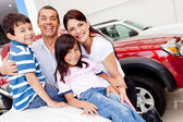Family shopping for new car — Stock Photo