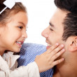 Affectionate girl with father - Stock Photo