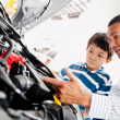 Father buying car with his son — Stock Photo