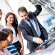 Stock Photo: Family buying a car