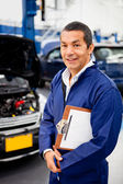 Mechanic at car garage — Stock Photo