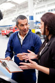 Woman at the car mechanic — Stock Photo