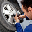 Mechanic fixing puncture — Stock Photo #9658053