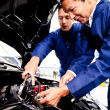 Mechanics fixing a car — Stock Photo #9658066