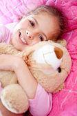 Girl with a teddy bear — Stock Photo