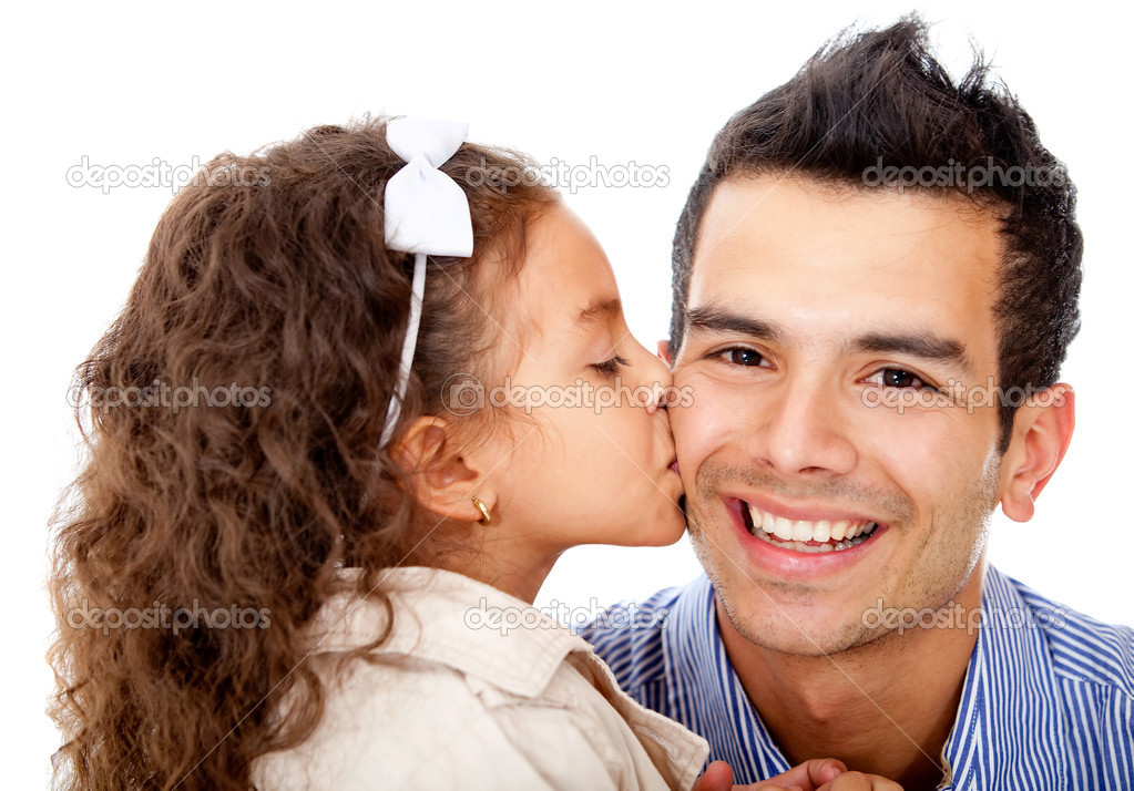 Girl kissing her father - isolated over a white background — Stock Photo #9658000