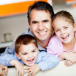 Stock Photo: Father with kids