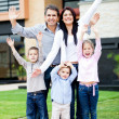 Stock Photo: Happy family with arms up
