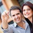 Beautiful couple holding keys — Stock Photo #9664844