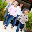 Stock Photo: Family running