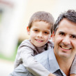 Father carrying his son — Stock Photo #9664857