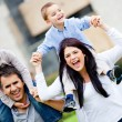 Happy family outdoors — Zdjęcie stockowe #9664865
