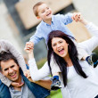Happy family outdoors — Stockfoto #9664865