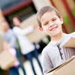 Boy moving house - Stock Photo