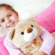 Girl with teddy bear - Stock Photo