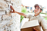 Delivery man ringing doorbell — Stock Photo