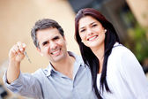 Couple with a key — Stock Photo