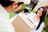 Mailman delivering a parcel — Stock Photo