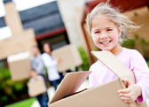 Girl moving house — Stock Photo