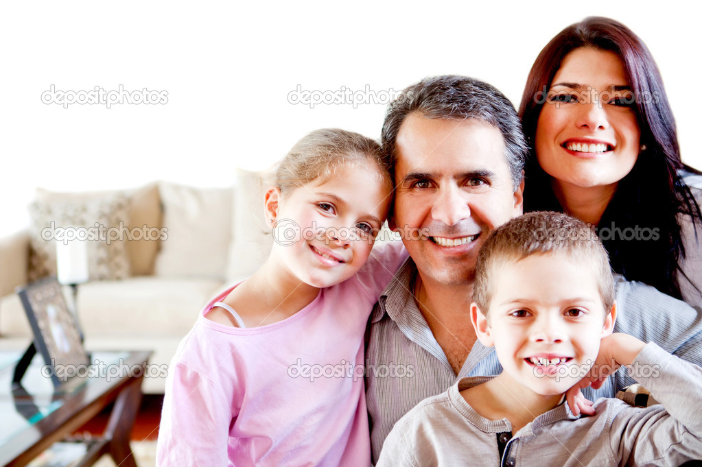 Beautiful family portrait smiling at home and looking happy — Stock Photo #9664822