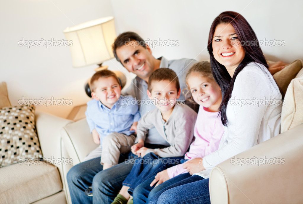 Beautiful family portrait sitting in the living room at home  Stock Photo #9664823