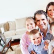 Family in the living room - Stock Photo