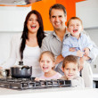 Family cooking dinner - Stock Photo