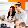Stock Photo: Family cooking dinner