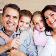 Happy family smiling - Stock Photo