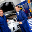 Mechanics fixing a car — Stock Photo