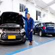 Stock Photo: Car mechanics smiling