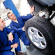 Stock Photo: Mechanics fixing puncture