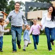 Stock Photo: Family running outdoors