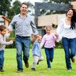 Family running outdoors — Stock Photo