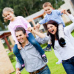 Family running outdoors — Stock Photo