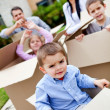 Boy moving house with family — Stock Photo