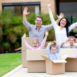 Stock Photo: Happy family moving house