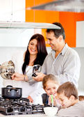 Family cooking dinner — Stock Photo