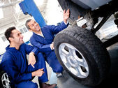 Mechanics fixing a puncture — Stock Photo