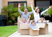 Happy family moving house — Stock Photo