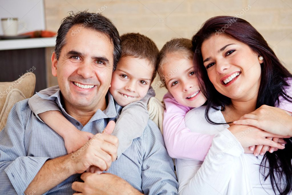 Portrait of a happy family smiling at home  Stock Photo #9677773