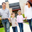 Stock Photo: Family outside home