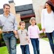Family outside home — Stock Photo