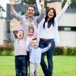 Happy family with arms up — Stock Photo #9774134